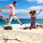 17659912 - happy people jumping on a beach. vacations by the sea