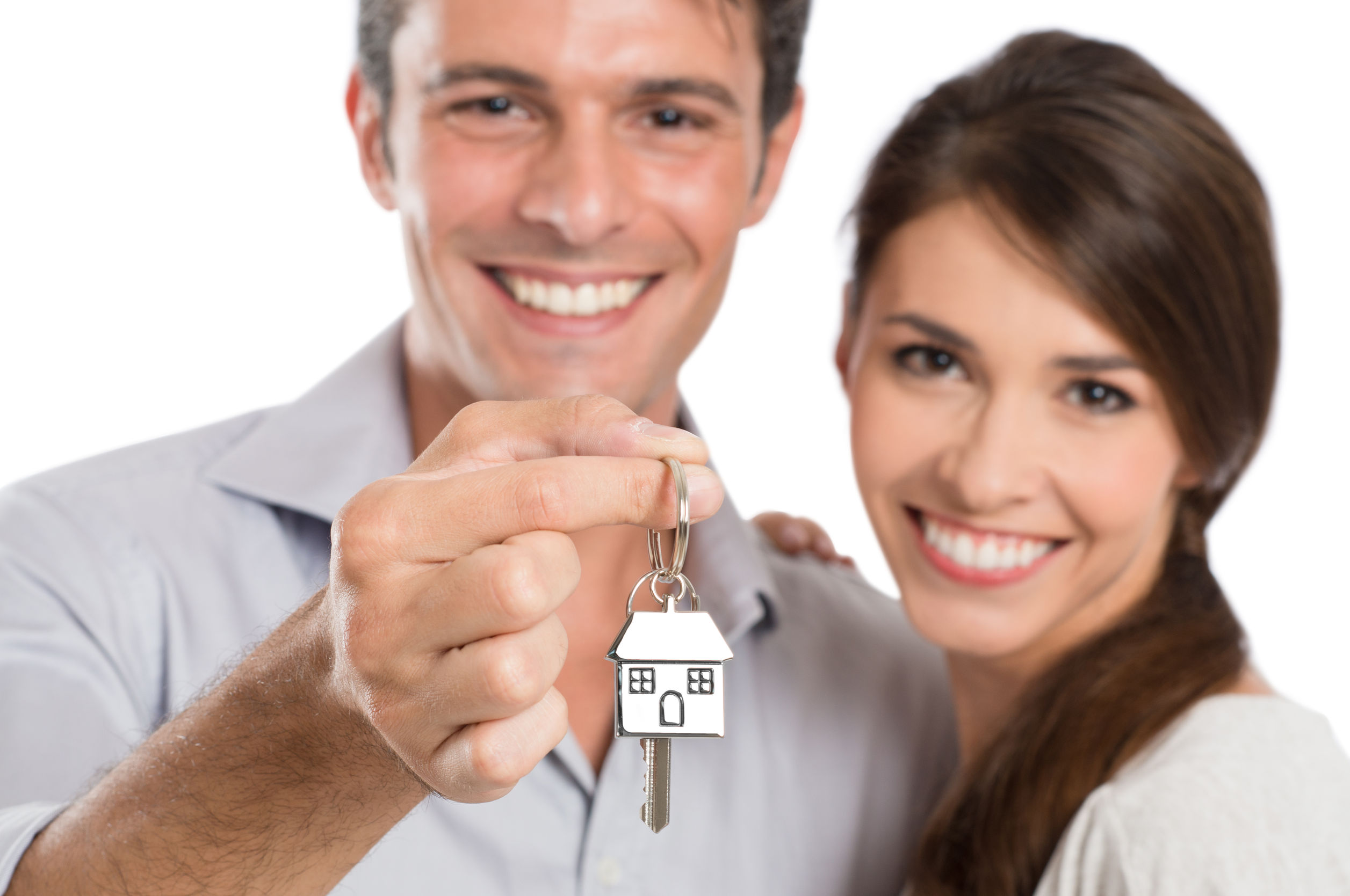 22583719 - happy smiling young couple showing key of their new house isolated on white background